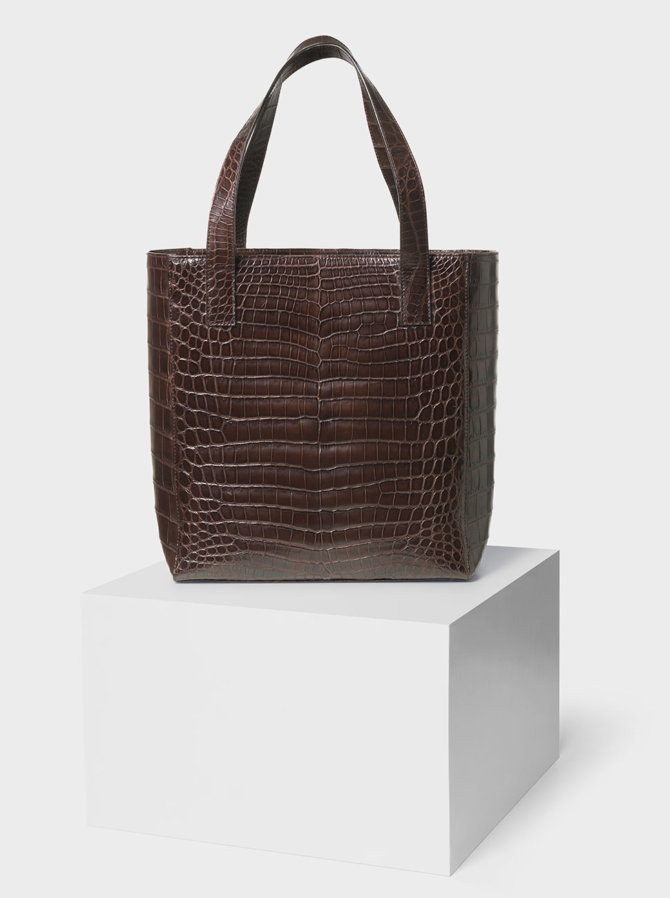 The Ned crocodile bag dark brown